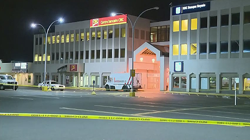Longueuil police say two men wearing Halloween masks attacked two employees of the Garda security firm at a Royal Bank branch in Brossard around 11 p.m. Thursday night.