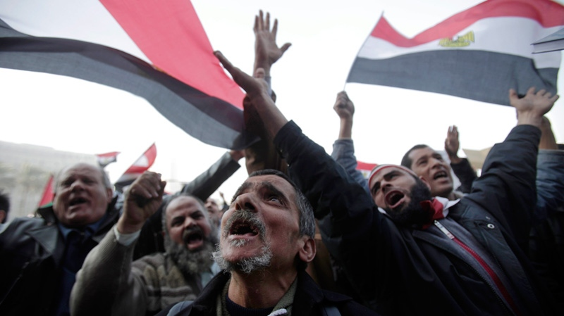 Egyptians gather in Tahrir Square to mark the one year anniversary of the uprising that ousted President Hosni Mubarak in Cairo, Egypt, Wednesday, Jan. 25, 2012. (AP / Muhammed Muheisen)