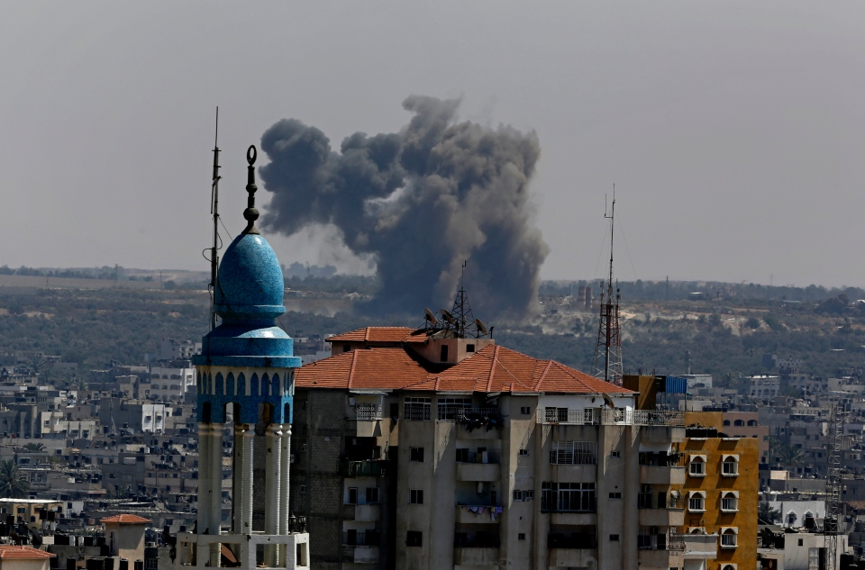Smoke and dust rise after an Israeli strike hits Gaza City in the northern Gaza Strip, Friday, Aug. 22, 2014. (AP / Adel Hana)