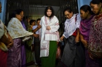 Irom Sharmila, center, walks out of a security ward after her release in Porompal district, in Imphal, India Wednesday, Aug. 20, 2014. (AP / Bullu Raj)