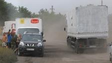 Aid trucks roll into eastern Ukraine
