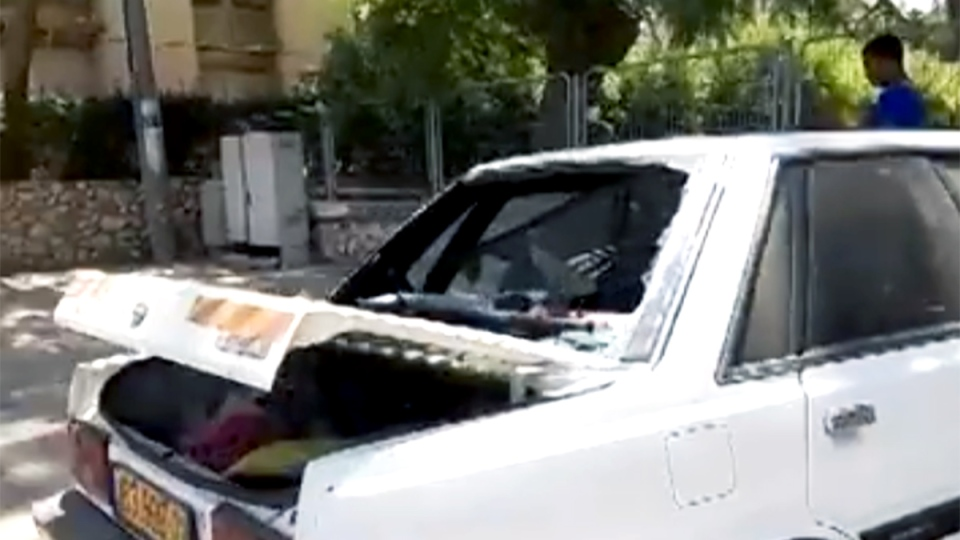 A damaged car after rocket fire from Gaza struck the town of Be'er Sheva in Israel, Friday, Aug. 22, 2014. (Vitali Berlinsky / YouTube)