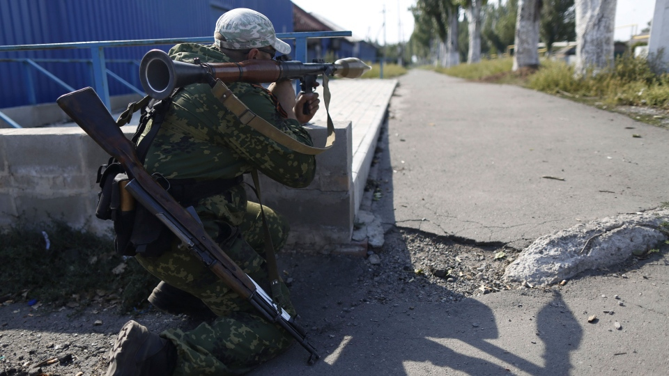 A pro-Russian rebel takes his position outside Donetsk, eastern Ukraine, Friday, Aug. 22, 2014. (AP / Max Vetrov)
