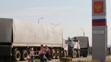 Russia aid trucks return from Ukraine