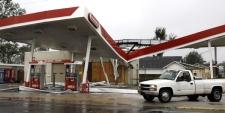 A driver surveys the damage to a Conoco gas station after hurricane Gustav stormed through Houma, Louisiana, on Monday, Sept. 1, 2008. (AP / Amy Sancetta)