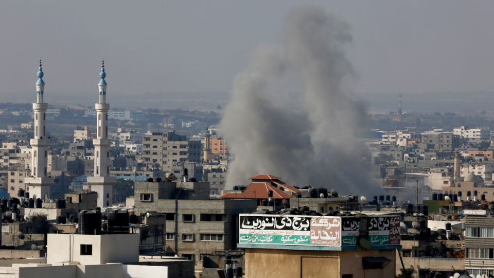 Smoke rises after an Israeli strike hits Gaza City on Saturday, Aug. 23, 2014. (AP / Adel Hana)