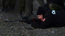 Harper shoots a .303 Lee Enfield rifle in Nunavut