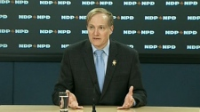 NDP Finance Critic Peter Julian reacts to Harper's speech on Thursday, Jan. 26, 2012.