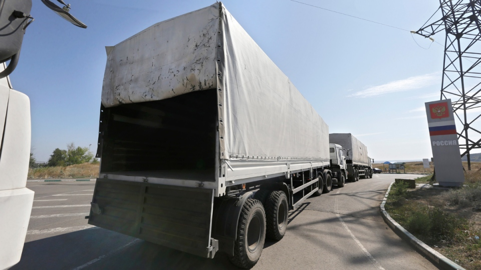 Trucks returning to Russia in the town of Donetsk, Rostov-on-Don, on Saturday, Aug. 23, 2014. (AP / Sergei Grits)