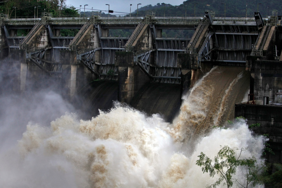 Water rushes through an open bay at the Carraizo Dam to release water left by a passing storm in Trujillo Alto, Puerto Rico, Saturday, Aug. 23, 2014. (AP / Ricardo Arduengo)