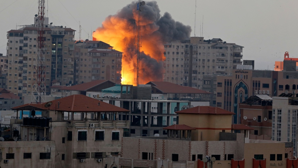 A ball of fire rises from an explosion on al-Zafer apartment tower following an Israeli air strike in Gaza City, in the northern Gaza Strip, Saturday, Aug. 23, 2014. (AP / Adel Hana)