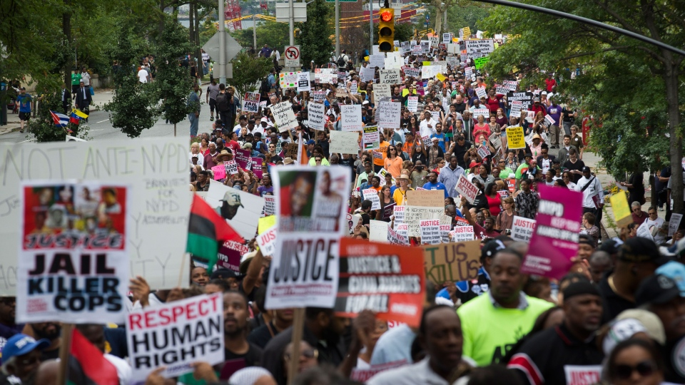Demonstrators march to protest the death of Eric Garner, in the Staten Island borough of New York on Saturday, Aug. 23, 2014. (AP / John Minchillo)