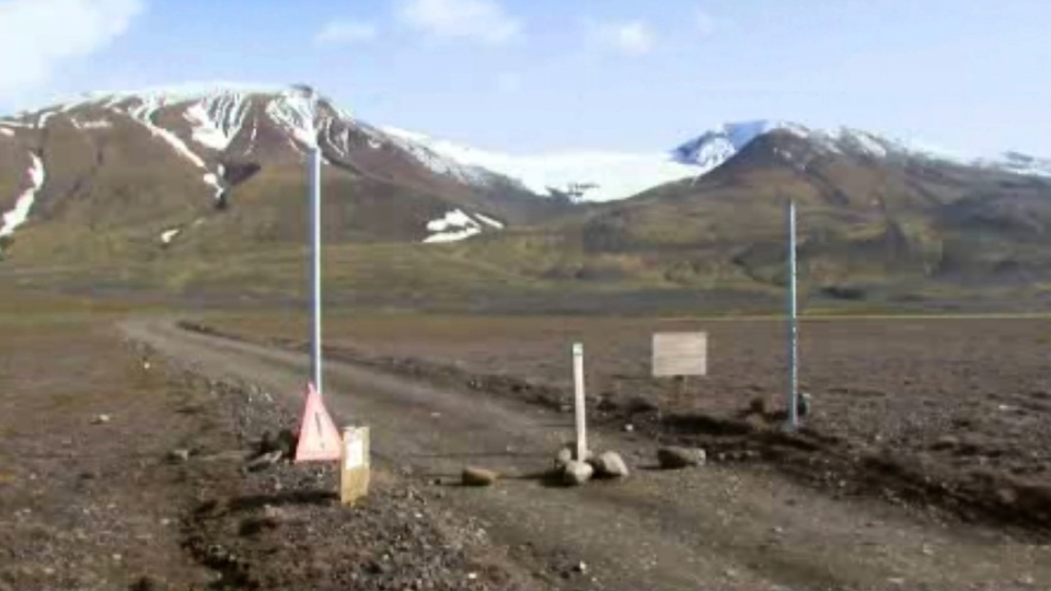 A sign is posted on the road next to Bardarbunga, a subglacial stratovolcano located under Iceland's largest glacier in this an video image taken on Aug. 19, 2014. (AP / Courtesy Channel 2 Iceland)