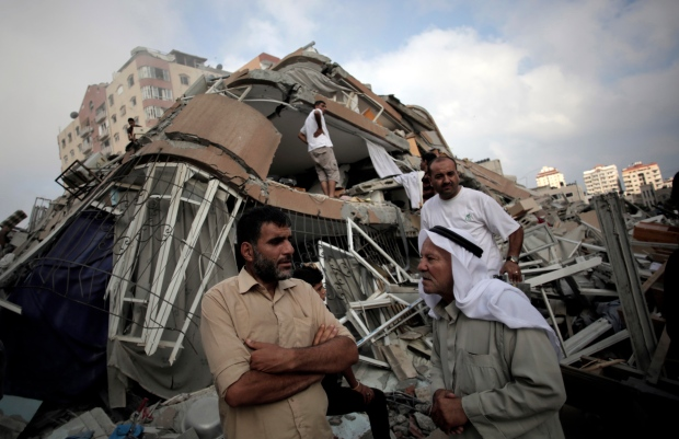 Israeli strikes topple large buildings in Gaza