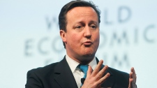 British Prime Minister David Cameron, gestures as he speaks during a session at the World Economic Forum in Davos, Switzerland, Thursday, Jan. 26, 2012. (AP / Michel Euler)