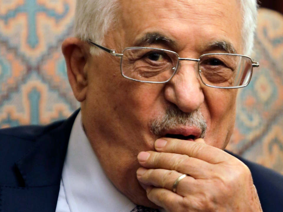 In this Wednesday, July 16, 2014, file photo, Palestinian President Mahmoud Abbas listens to Arab League Secretary General Nabil Elaraby during their meeting at his residence in Cairo. (AP / Amr Nabil)