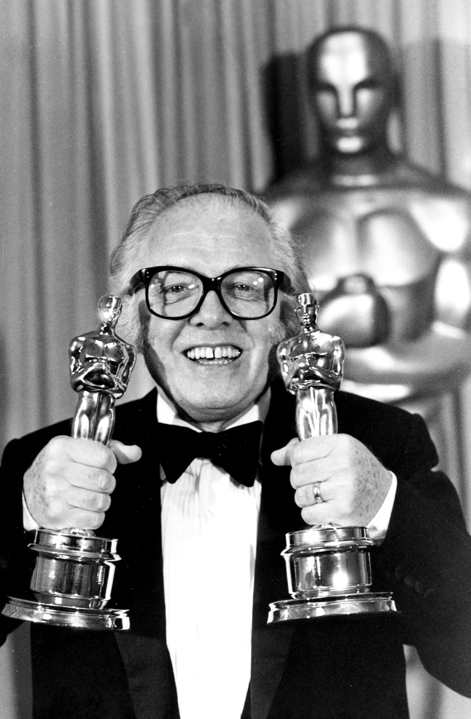 "British actor and director Richard Attenborough holds his two Oscars for his epic movie ""Gandhi"" at the 55th annual Academy Awards in Los Angeles, Ca. Monday, April 11, 1983. (AP Photo)"