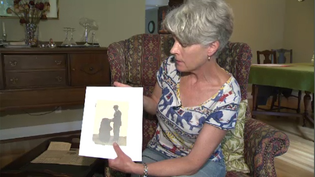 Brenda Colebourn, granddaughter of Lt. Harry Colebourn, holds a picture of him with Winnie the bear.