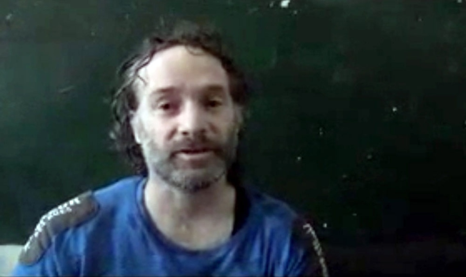 In this image made from undated video obtained by The Associated Press, which has been authenticated based on its contents and other AP reporting, a man believed to be Peter Theo Curtis, a U.S. citizen held hostage by an al-Qaida linked group in Syria, delivers a statement. (AP Photo)