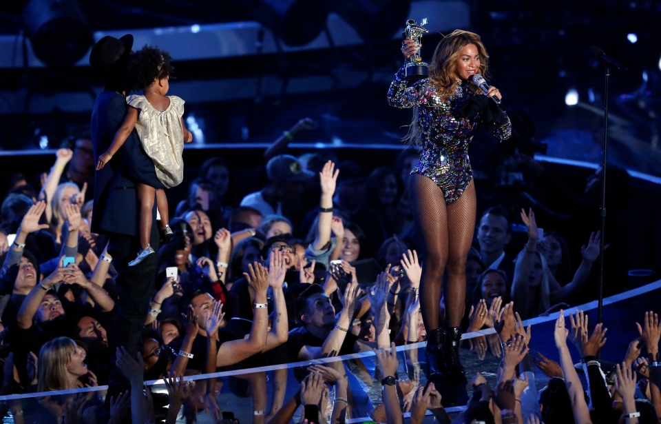 Beyonce accepts the Video Vanguard Award with Blue Ivy and Jay-Z at left during the MTV Video Music Awards at The Forum on Sunday, Aug. 24, 2014, in Inglewood, Calif. (Invision /  Matt Sayles)