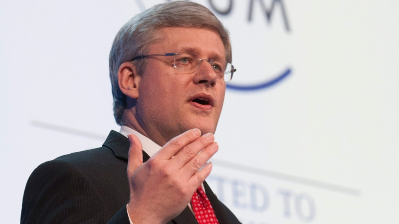 Prime Minister Stephen Harper delivers his address to business leaders at the World Economic Forum in Davos, Thursday Jan. 26, 2012. (Adrian Wyld / THE CANADIAN PRESS)