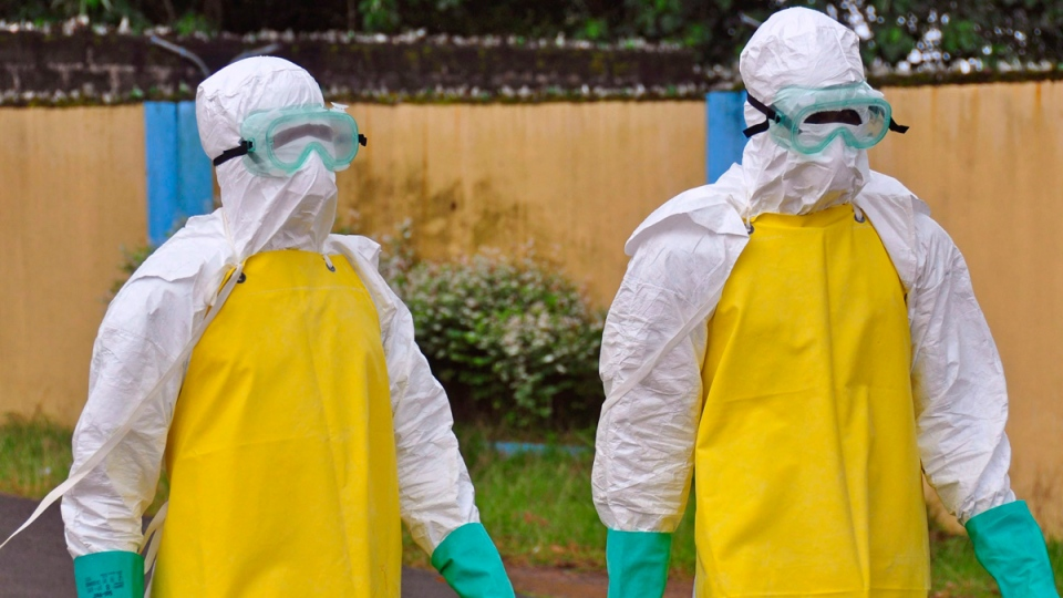 Health workers in Monrovia, Liberia, Saturday, Aug. 16, 2014. (THE CANADIAN PRESS / AP / Abbas Dulleh)