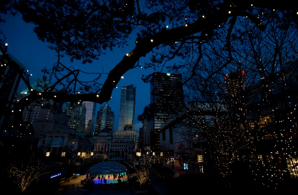 A tree covered in Christmas lights frames the University of British Columbia skating rink in downtown Vancouver, B.C., on Tuesday, December, 18, 2012. (Jonathan Hayward / THE CANADIAN PRESS)