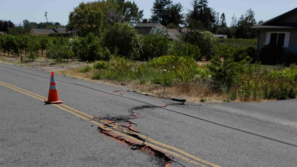 A cracked section of roadway is shown in the Carneros district following an earthquake Sunday, Aug. 24, 2014, in Napa, Calif. (AP / Eric Risberg)