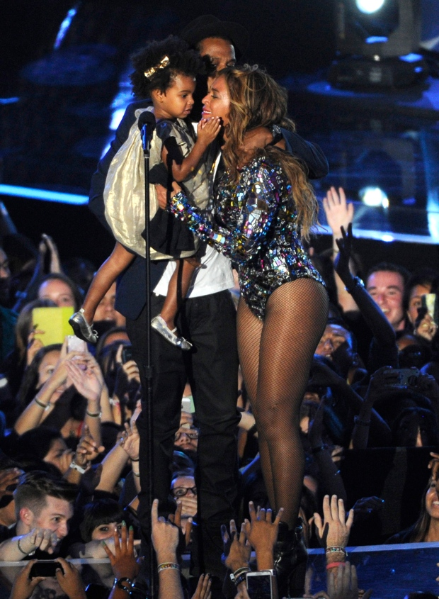 Beyonce on stage hugs Jay Z and Blue Ivy