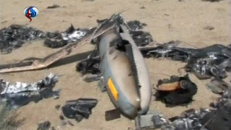 Image from Iranian state TV channel Al-Alam, of the purported Israeli drone Iran's Revolutionary Guard claimed to have shot down near an Iranian nuclear site. (AP / Al-Alam TV)
