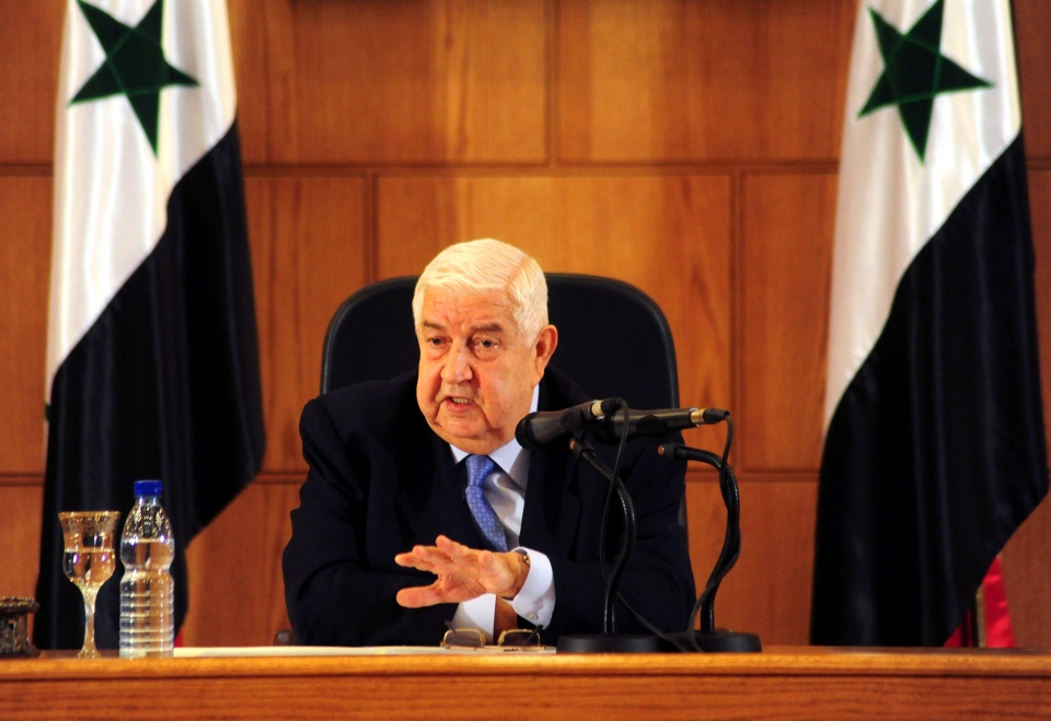 In this photo released by the Syrian official news agency SANA, Syrian Foreign Minister Walid al-Moallem speaks during a press conference, in Damascus, Syria on Monday, Aug. 25, 2014. (SANA)
