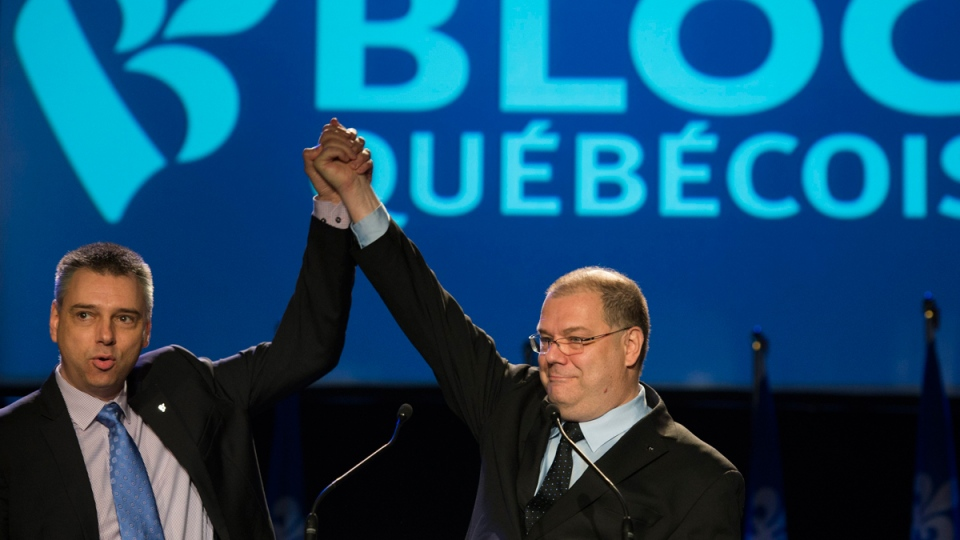 Mario Beaulieu, right, with André Bellavance in Montreal, on June 14, 2014. (THE CANADIAN PRESS / Graham Hughes)