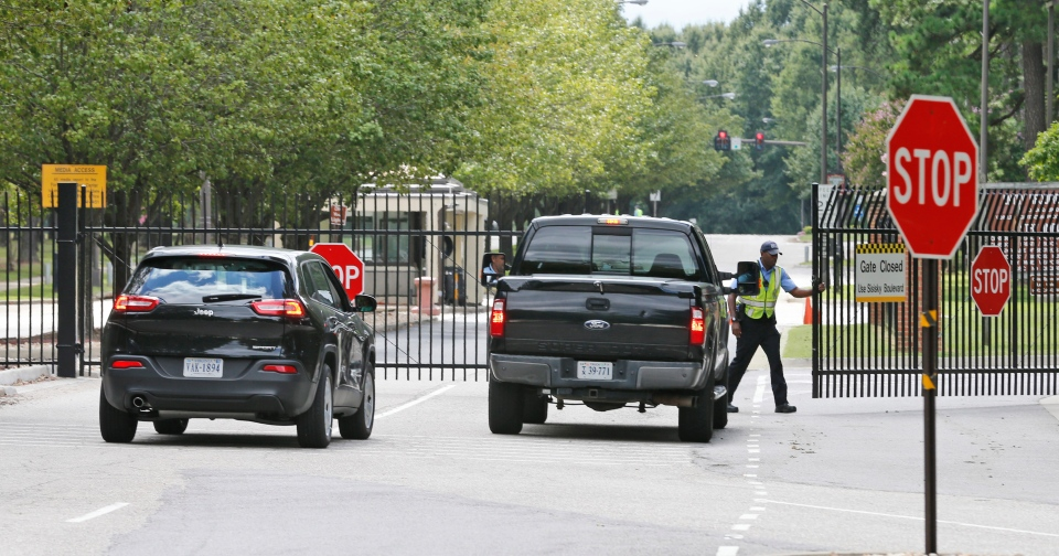 Security guards open a gate for motorist at the visitor entrance to Fort Lee, Va., Monday, Aug. 25, 2014. (AP / Steve Helber)