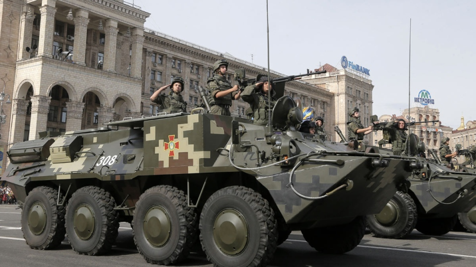 Ukrainian military vehicles pass down Kyiv's main street during a military parade to mark the 23rd anniversary of Ukraine's Independence, in the capital Kyiv, Sunday, Aug. 24, 2014. (AP / Efrem Lukatsky)