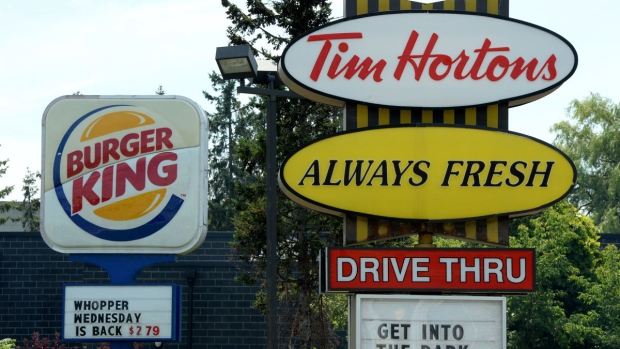 A Burger King sign and a Tim Hortons sign