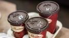 Cups of coffee sit on a counter in a Tim Hortons outlet in Oakville, Ontario on Monday September 16, 2013. (THE CANADIAN PRESS/Chris Young)