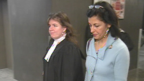 Mitra Javanmardi and her lawyer walk through the Montreal courthouse (Jan. 26, 2012)