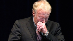 Phil Knight, former CEO and co-founder of Nike, becomes emotional as he speaks during a memorial service for former Penn State football coach Joe Paterno at Penn State's Bryce Jordan Center in State College, Pa. Thursday Jan. 26, 2012.