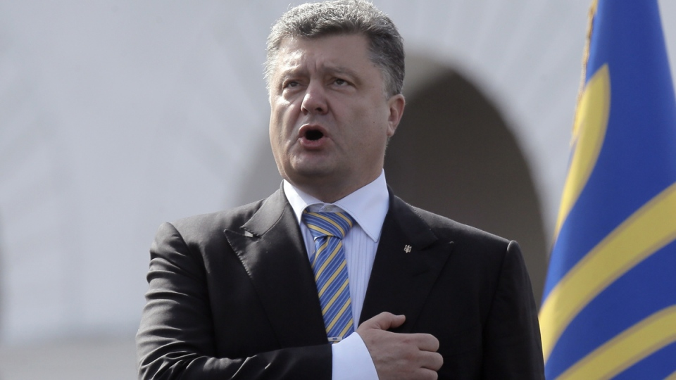 Ukraine President Petro Poroshenko sings the national anthem during a parade to celebrate Ukraine's Independence Day in Kyiv, Ukraine, Sunday, Aug. 24, 2014. (AP / Efrem Lukatsky)