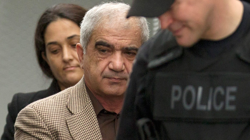 Mohammad Shafia (front) and Tooba Yahya are escorted into the Frontenac County courthouse in Kingston, Ont., Friday, Jan. 27, 2012. (Frank Gunn / THE CANADIAN PRESS)