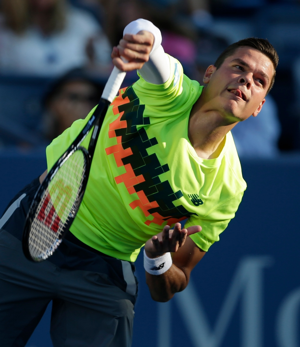 Milos Raonic, of Canada, serves to Taro Daniel, of Japan, during the opening round of the U.S. Open tennis tournament Monday, Aug. 25, 2014, in New York. (AP / Darron Cummings)