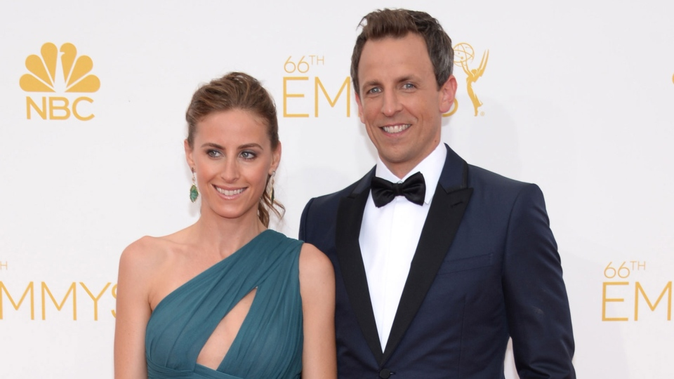 Alexi Ashe, left and Seth Meyers arrive at the 66th Primetime Emmy Awards at the Nokia Theatre L.A. Live in Los Angeles on Monday, Aug. 25, 2014. (Evan Agostini / Invision)