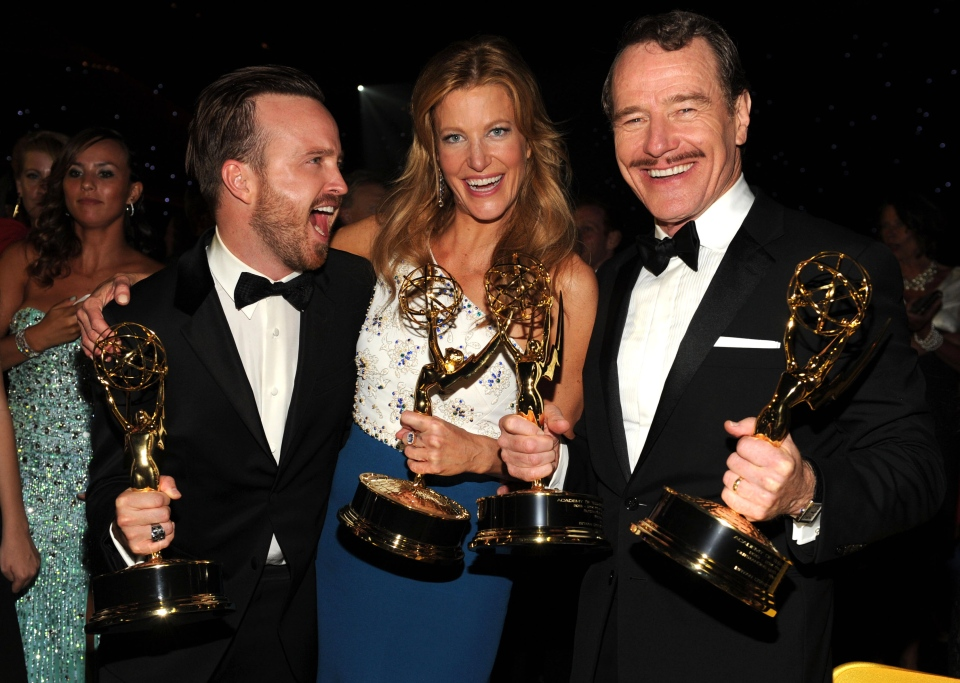 Aaron Paul, from left, Anna Gunn and Bryan Cranston attend the Governors Ball at the 66th Primetime Emmy Awards at the Nokia Theatre L.A. Live on Monday, Aug. 25, 2014, in Los Angeles. (Photo by Frank Micelotta/Invision for the Television Academy/AP Images)