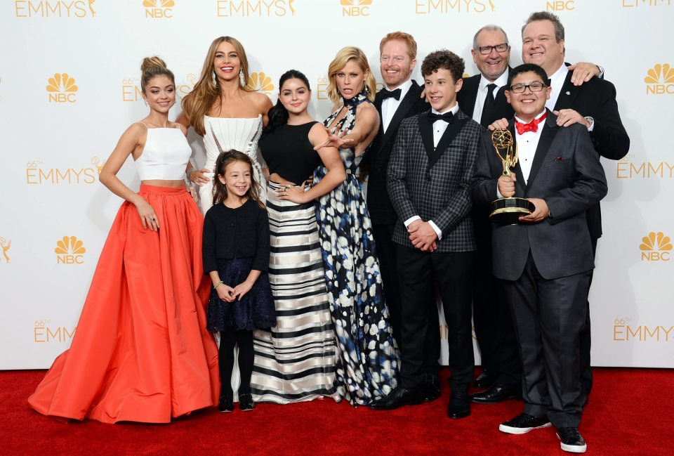 Sarah Hyland, from left, Sofia Vergara, Aubrey Anderson-Emmons, Ariel Winter, Julie Bowen, Jesse Tyler Ferguson, Nolan Gould, Ed O'Neill, Eric Stonestreet and Rico Rodriguez pose in the press room with the award for outstanding comedy series for Modern Family at the 66th Annual Primetime Emmy Awards, Monday, Aug. 25, 2014. (Jordan Strauss / Invision)