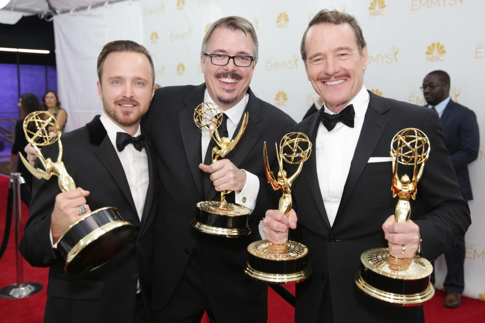 Aaron Paul, and from left, Vince Galligan, and Bryan Cranston pose with their awards for outstanding drama series for their work on 'Breaking Bad' at the 66th Primetime Emmy Awards at the Nokia Theatre L.A. Live, Monday, Aug. 25, 2014. (Casey Curry / Invision for the Television Academy)