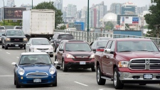 Vehicles move in Vancouver on Wednesday, June 4, 2014.  (Jonathan Hayward / THE CANADIAN PRESS)