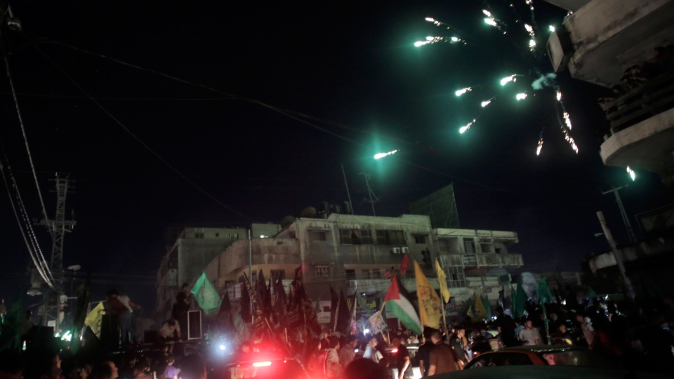 Palestinians celebrate the cease-fire in Gaza City, Tuesday, Aug. 26, 2014. (AP / Khalil Hamra)