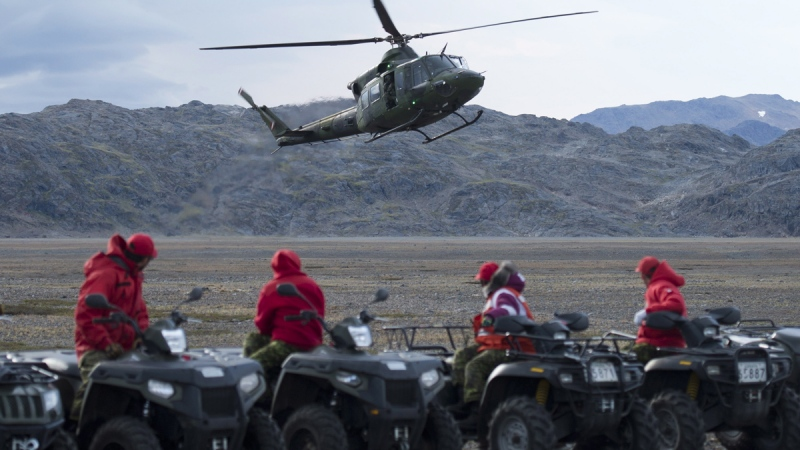 Canadian Rangers watch a Gryffon helicopter land near a camp nera York Sound, Nunavut, Tuesday, Aug. 26, 2014. (Adrian Wyld / THE CANADIAN PRESS)