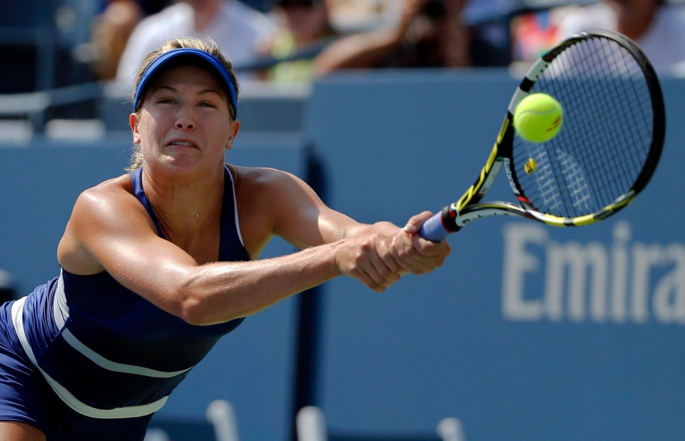 Eugenie Bouchard returns a shot against Olga Govortsova, of Belarus, during the first round of the 2014 U.S. Open tennis tournament, Tuesday, Aug. 26, 2014, in New York. (AP / Elise Amendola)