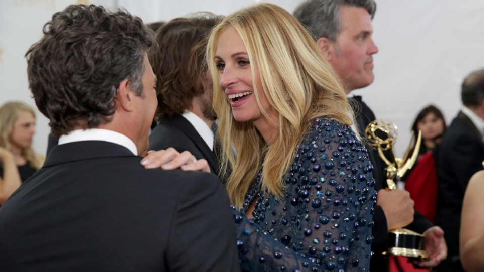 Mark Ruffalo, left, and Julia Roberts speak backstage at the 66th Primetime Emmy Awards at the Nokia Theatre L.A. Live on Monday, Aug. 25, 2014, in Los Angeles. (AP / Casey Curry / Invision for the Television Academy)